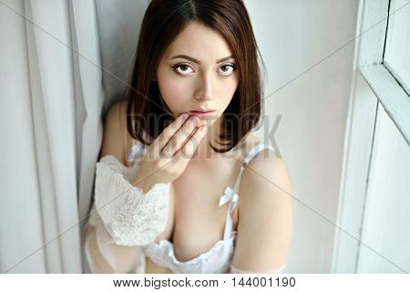 Female Portrait Of Cute Lady In White Bra Indoors. Close-up Beautiful Sexy Model Girl In Elegant Pos