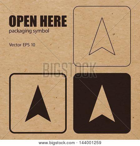 Open Here vector packaging symbol on vector cardboard background. Handling mark on craft paper background. Can be used on a box or packaging. Vector EPS 10.
