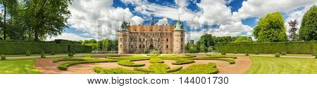 Kvaerndrup, Denmark - August 11, 2016: Panorama Of Egeskov Castle, located in the south of the island of Funen, Denmark. Vintage look.