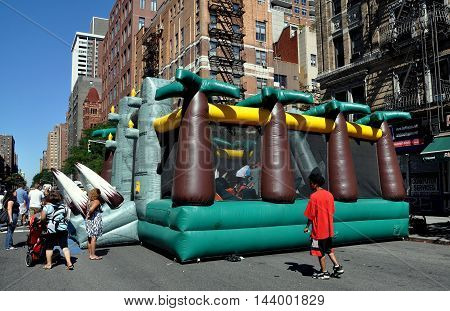 New York City - August 29 2010: Inflated plastic children's play house at an Amsterdam Avenue Summer Festival