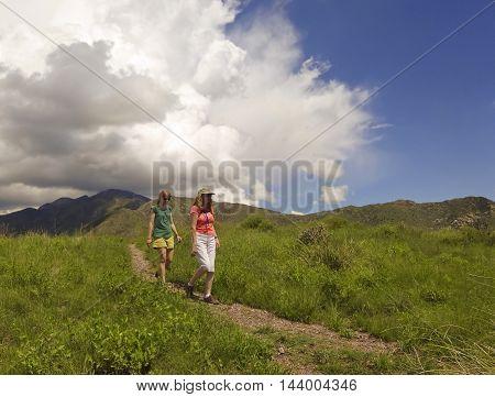 SIERRA VISTA, ARIZONA, AUGUST 21. Coronado Peak on August 21, 2016, near Sierra Vista, Arizona. A mother and daughter hike the trail on top of Coronado Peak in the Huachuca Mountains near Sierra Vista Arizona.