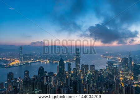 Famed Skyline Of Hong Kong From Victoria Peak In A Foggy Morning.