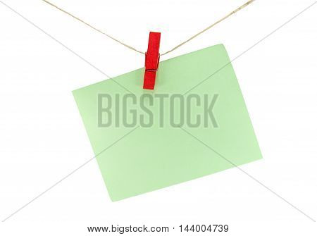 Green Sheet Of Paper For Notes And Paperclip Isolate On White