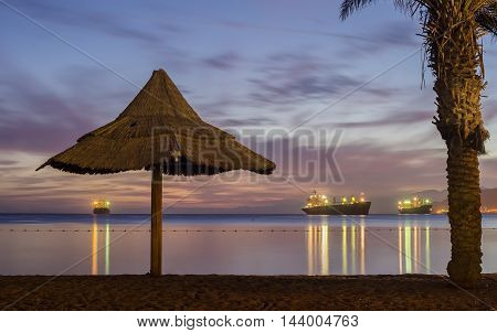 Nocturnal view on the Red Sea from central beach of Eilat - famous resort and recreational city of Israel