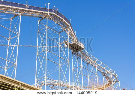 tracks of Roller coaster against blue sky.