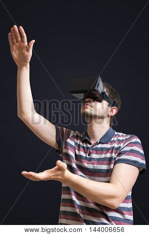 Young Man Is Wearing 3D Virtual Reality Glasses. Isolated On Bla