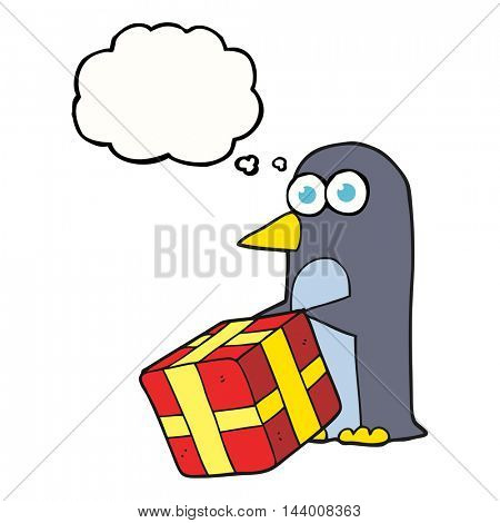 freehand drawn thought bubble cartoon penguin with christmas present