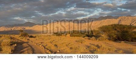 Desert road between Jordan and Israel in the Great Rift Valley near Aqaba and Eilat cities, border between Israel and Jordan