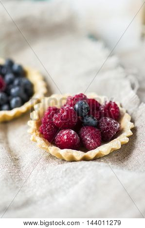 baked basket filled with fresh blueberries and raspberries