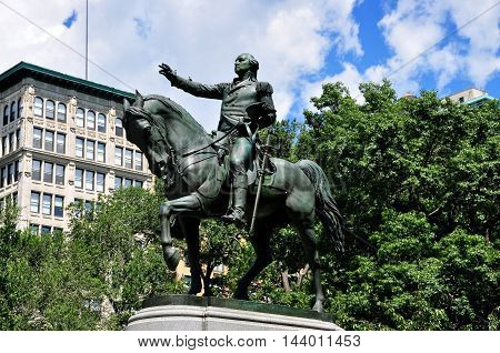 New York City - August 3 2013: Equestrian statue of George Washington astride his horse atop a pedestal in Union Square