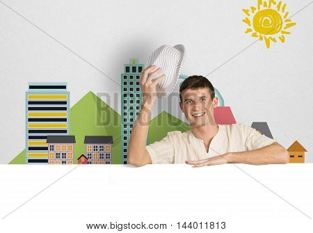 Portrait of handsome male holding blank white ad board