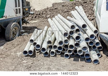 Pile of used pipes for drilling water wells waiting to drill into deep ground.