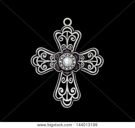 cross pendant isolated on black background