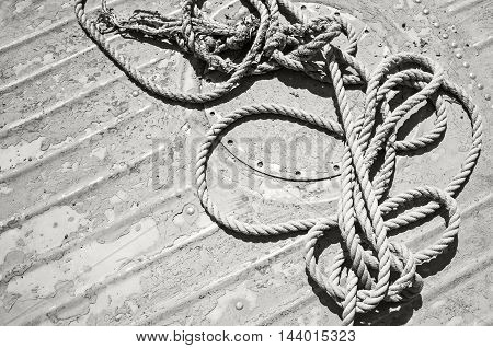 Knotted Mooring Rope Lying On Grungy Boat Deck