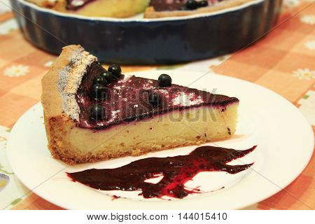 piece of fresh pie with bilberry on the plate