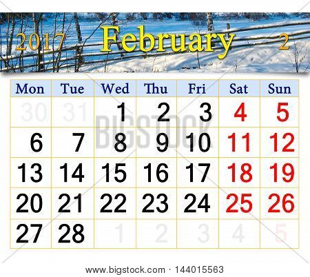 calendar for February of 2017 on the background of rural winter landscape