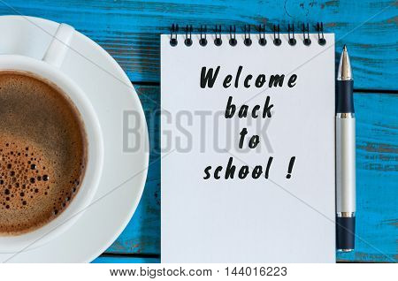 Welcome back to school. September beginning concept written at notepad with morning cup of coffee.