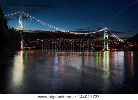 Lions Gate Bridge Twilight. The Lions Gate bridge at twilight. Stanley Park. Vancouver, British Columbia, Canada.