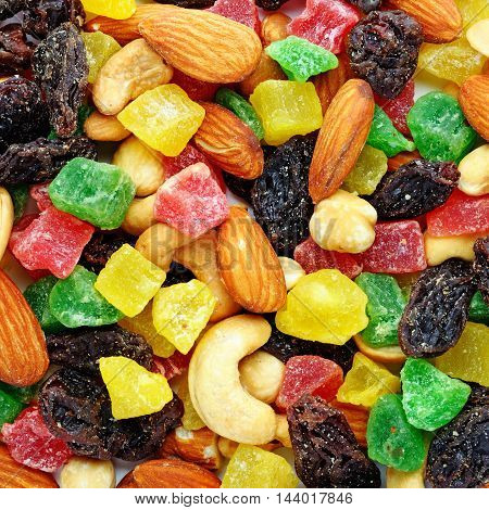 Candied fruits and toasted nuts close-up background
