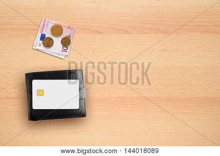 Wallet money and credit card mock-up on desk
