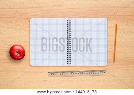 School notebook apple pencil and ruler on desk top view