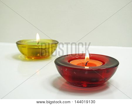 Candles in red and yellow transparent chandeliers