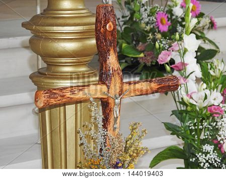 wooden cross with a statue of Jesus in church
