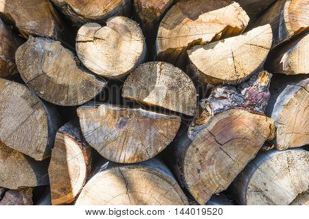 Fresh pine wood lying in the yard of the house.