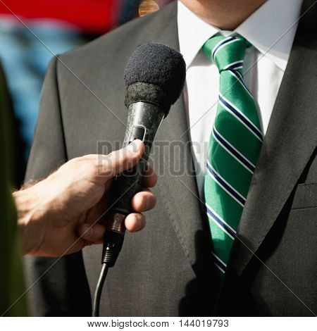 Interviewing businessman, toned image, close up, unrecognizable people