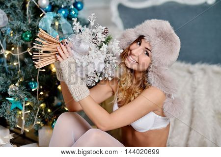 Beautiful Sexy Santa Clause In Elegant Stockings, Hat And Bra. Fashion Portrait Of Model Girl Indoor