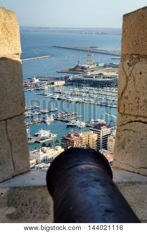 Ancient cannon on the top of Alicante castle Santa Barbara, summer Spain