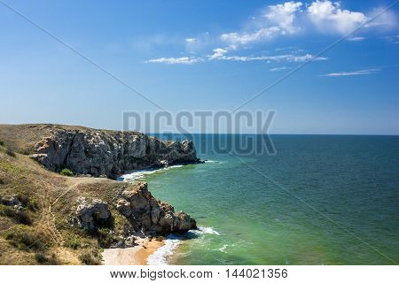 stone cliffs on the coast and blue sky