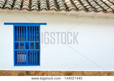 Colonial Wall And Blue Window
