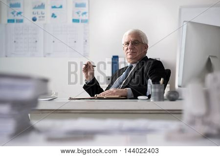 Portrait of senior businessman working in his office