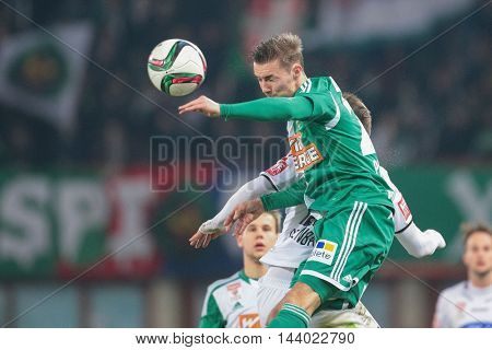 VIENNA, AUSTRIA - FEBRUARY 28, 2015: Daniel Offenbacher (#20 Sturm Graz) and Mario Pavelic (#22 Rapid) fight for the ball in an Austrian football league game.