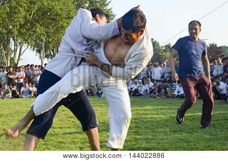 Istanbul Turkey - July 31 2016: in Zeytinburnu district of Istanbul Turkmen wrestling sports events held in the coastal meadows. Turkmen Uzbek Afghan Turkish Turkmenistan Turkey and other Asian youth are competing in the wrestling meadow.