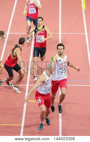 PRAGUE, CZECH REPUBLIC - MARCH 8, 2015: akub Krezwina (Poland) and Lukasz Krawczuk (Poland) compete in the men's 4x400m relay event of the European Athletics Indoor Championship.