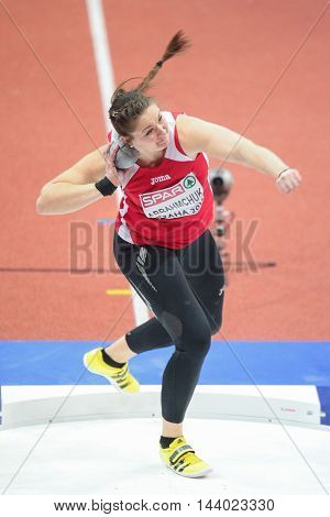 PRAGUE, CZECH REPUBLIC - MARCH 5, 2015: Alena Abrahmchuk (#511 Belarus) competes in the women's shot put event of the European Athletics Indoor Championship.