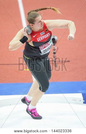 PRAGUE, CZECH REPUBLIC - MARCH 5, 2015: Lena Urbaniak (#618 Germany) competes in the women's shot put event of the European Athletics Indoor Championship.
