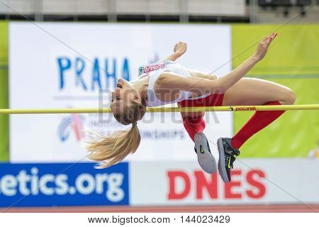 PRAGUE, CZECH REPUBLIC - MARCH 7, 2015: Kamila Licwinko (#685 Poland) competes in the women's high jump event of the European Athletics Indoor Championship.