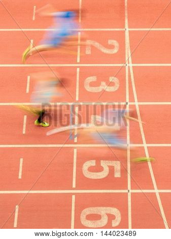 LINZ, AUSTRIA - FEBRUARY 21, 2015: Runners cross the finishing line in the men's 60m event in an indoor track and field event.