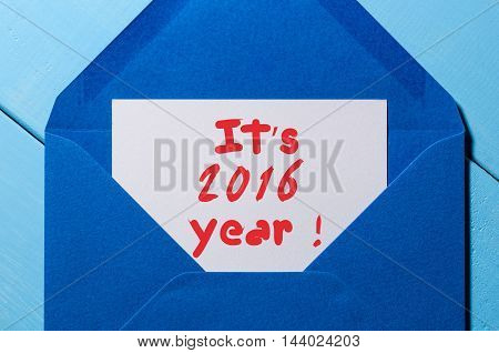 It's 2016 written on letter at blue envelope.