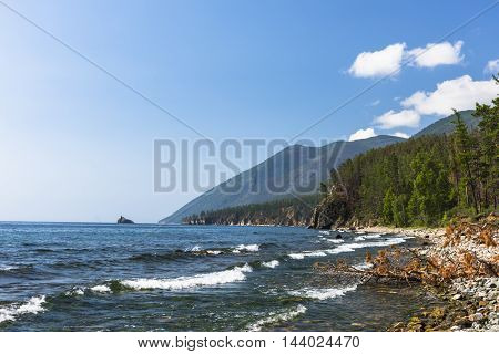 Suddenly changed weather and strong the waves crash on the rocky shore of lake Baikal.