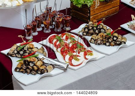 Catering service. Kebabs, salmon, caprese and other tasty food