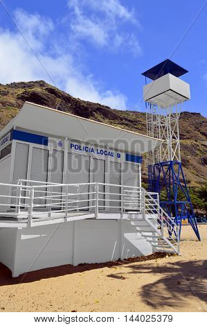Playa De Las Teresitas beach Tenerife Canary Islands Spain Europe - June 14 2016 : Local Police station and lookout tower on Playa De Las Teresitas beach in Tenerife