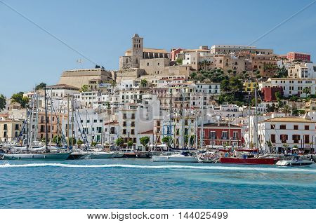 Ibiza Spain - June 3 2016: View of the Dalt Vila (Upper Town) of Eivissa (Ibiza Town) with its cathedral marina and sailing boats
