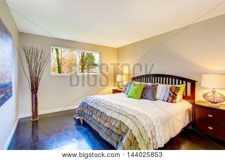 Bedroom With Beige Walls, Hardwood Floor And King Size Bed