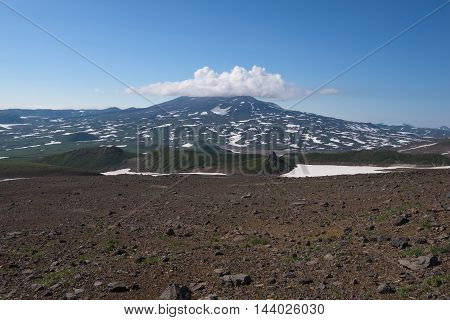 Top of Vilyuchinskaya volcano hidden in the clouds, viewed from Gorely Volcano, Kamchatka, Russia