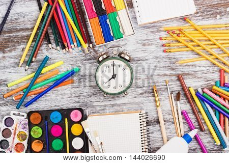 Different School Supplies On The Wooden Background