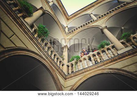 Wedding couple on italian courtyard at wedding